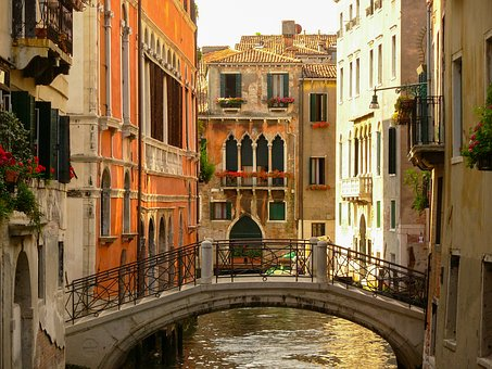 Venice bridge and arched windows