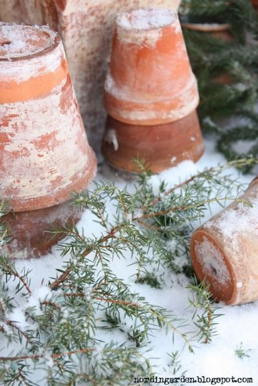 terra cotta post snow and greenery