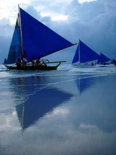 blue sails boats
