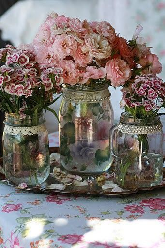 glass jars with flowers